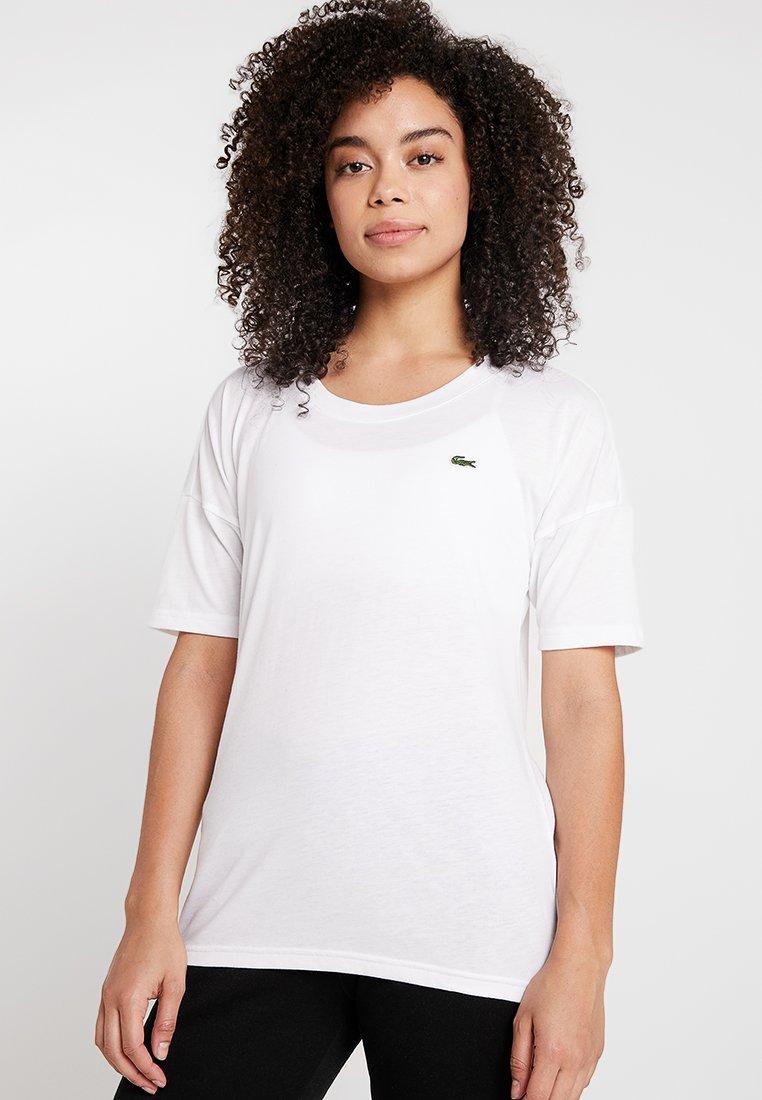 Lacoste Sport - T-Shirt print - white/black