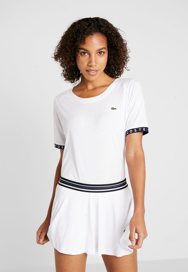 TENNIS  - T-shirt z nadrukiem - white/navy blue