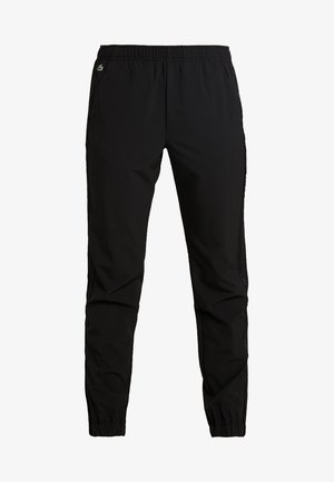 WOMEN TENNIS TROUSERS - Pantalones deportivos - black