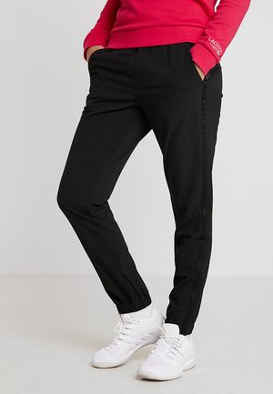 WOMEN TENNIS TROUSERS - Verryttelyhousut - black
