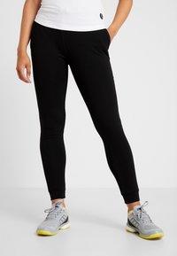 Lacoste Sport - WOMEN TENNIS TROUSERS - Pantalones deportivos - black - 0