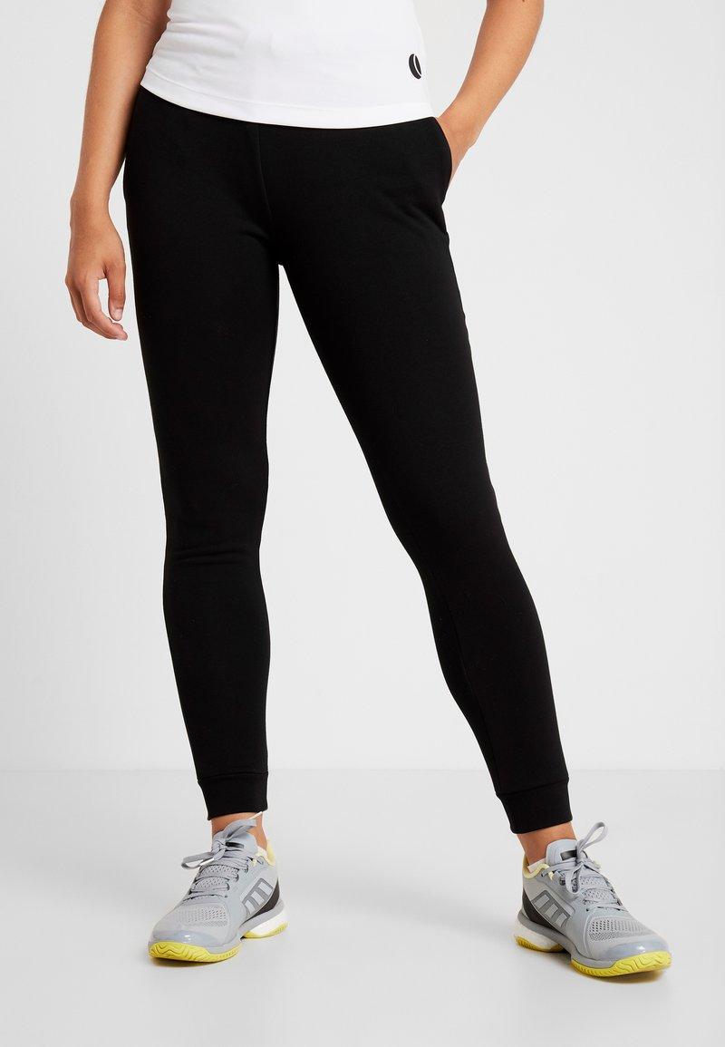 Lacoste Sport - WOMEN TENNIS TROUSERS - Pantalones deportivos - black