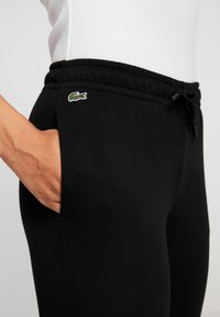 Lacoste Sport - WOMEN TENNIS TROUSERS - Pantalones deportivos - black - 4