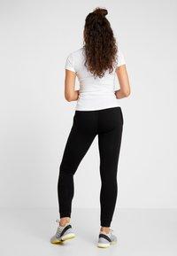 Lacoste Sport - WOMEN TENNIS TROUSERS - Pantalones deportivos - black - 2