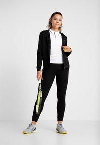Lacoste Sport - WOMEN TENNIS TROUSERS - Pantalones deportivos - black - 1