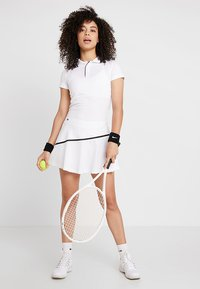 Lacoste Sport - TENNIS SKIRT - Sports skirt - white/black - 1