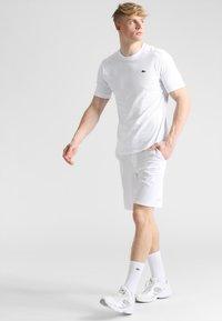 Lacoste Sport - HERREN - Basic T-shirt - white - 1