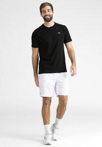 Lacoste Sport - CLASSIC - Basic T-shirt - black - 1