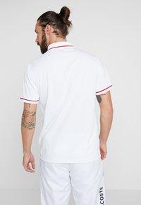 Lacoste Sport - Camiseta de deporte - white/red - 2