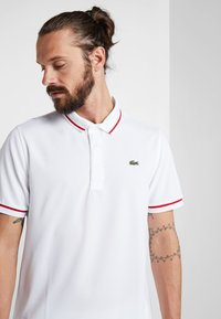 Lacoste Sport - Camiseta de deporte - white/red - 3