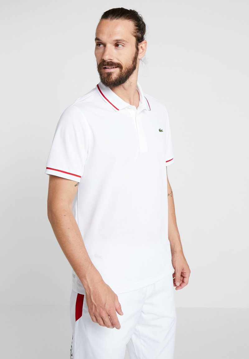 Lacoste Sport - Camiseta de deporte - white/red