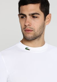 Lacoste Sport - GOLF PERFORMANCE LONG SLEEVE  - Sportshirt - white - 3