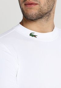 Lacoste Sport - GOLF PERFORMANCE LONG SLEEVE  - Sportshirt - white - 5