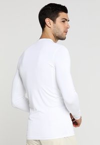 Lacoste Sport - GOLF PERFORMANCE LONG SLEEVE  - Sportshirt - white - 2