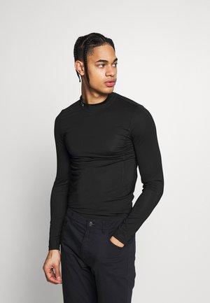 GOLF PERFORMANCE LONG SLEEVE  - Sports shirt - black
