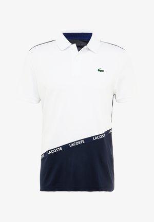 TENNIS TAPERED - Polo shirt - white/navy blue ocean