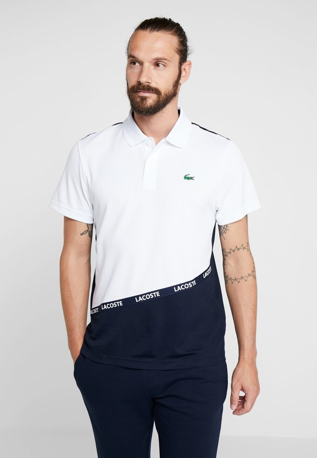 TENNIS TAPERED - Polo shirt - white/navy blue ocean
