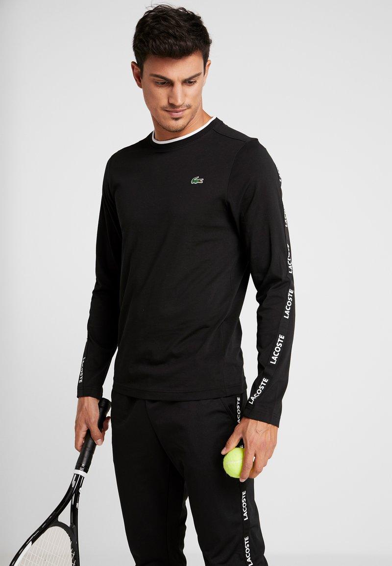 Lacoste Sport - LONGSLEEVE TAPERED - Sports shirt - black/white