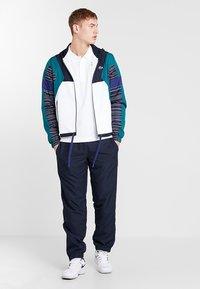 Lacoste Sport - DJOKOVIC - Polo - white/navy blue - 1
