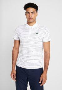 Lacoste Sport - Camiseta de deporte - white/navy blue - 0