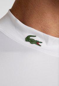 Lacoste Sport - UNDERLAYER - Sports shirt - white - 5