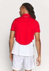 Lacoste Sport - Polo shirt - corrida/white/black - 2
