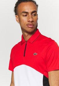 Lacoste Sport - Polo shirt - corrida/white/black - 4