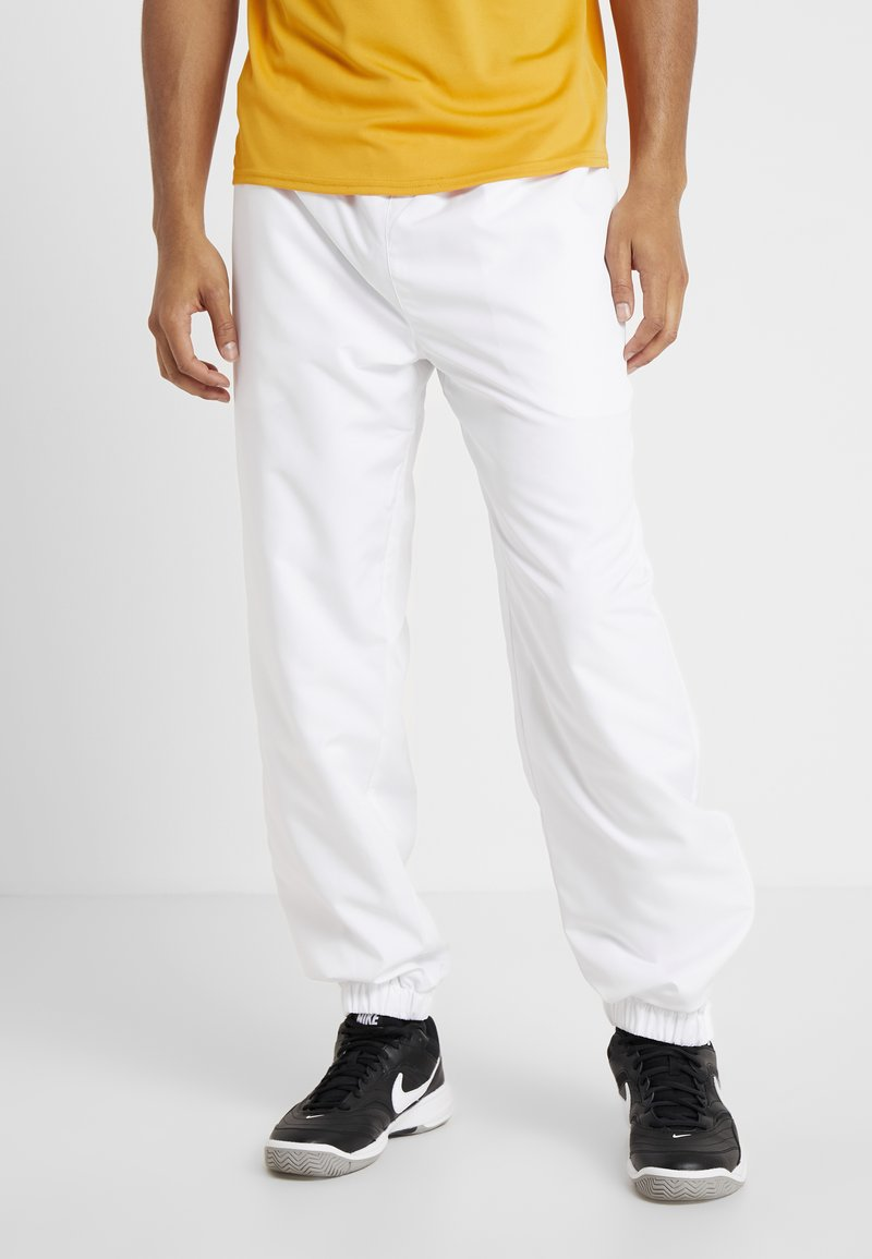 Lacoste Sport - Tracksuit bottoms - white