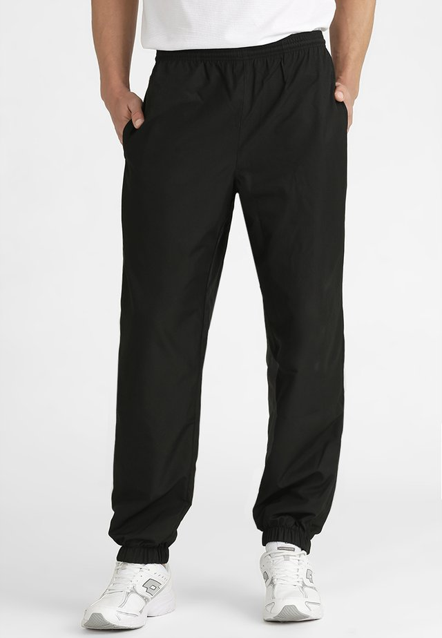 TENNIS PANT - Jogginghose - black