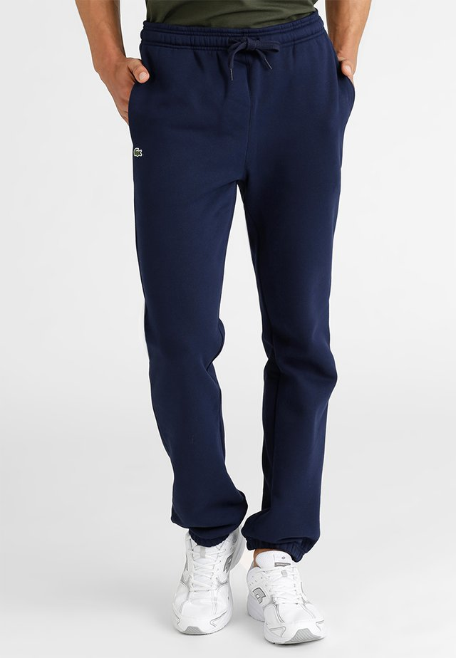 HERREN - Tracksuit bottoms - navy blue