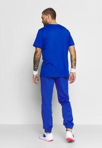 Lacoste Sport - HERREN - Träningsbyxor - blue - 2