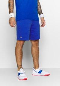 Lacoste Sport - MEN TENNIS SHORT - Krótkie spodenki sportowe - blue - 1