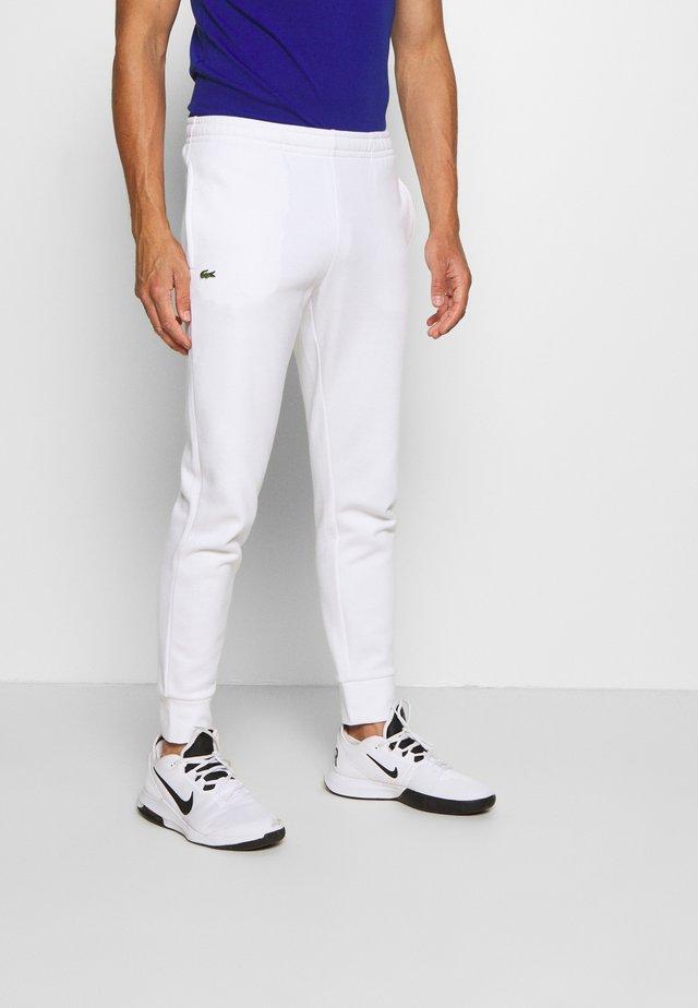 CLASSIC PANT - Verryttelyhousut - white