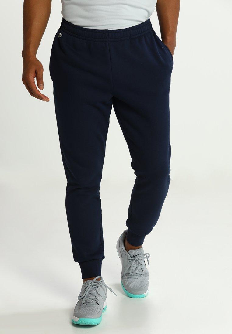 Lacoste Sport - Tracksuit bottoms - navy blue