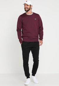 Lacoste Sport - Pantalon de survêtement - black - 1