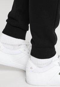 Lacoste Sport - Pantalon de survêtement - black - 3