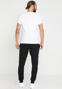 Lacoste Sport - Pantalon de survêtement - black - 2