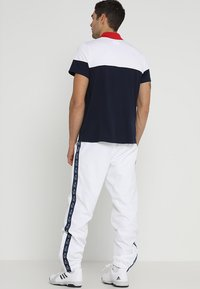 Lacoste Sport - Träningsbyxor - white/navy blue - 2