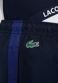 Lacoste Sport - PANT - Tracksuit bottoms - navy blue/ocean/white - 6