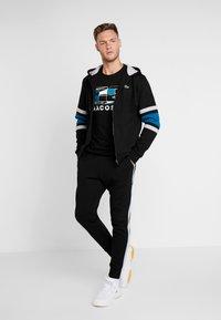 Lacoste Sport - Teplákové kalhoty - black/silver - 1