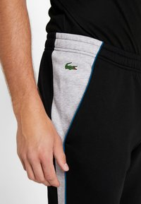 Lacoste Sport - Teplákové kalhoty - black/silver - 4