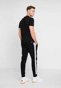 Lacoste Sport - Teplákové kalhoty - black/silver - 2