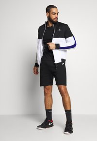 Lacoste Sport - SHORT TAPERED - Sports shorts - black/silver chine - 1
