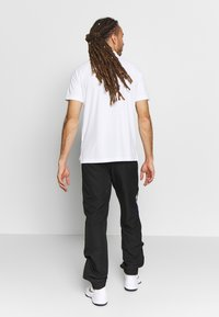 Lacoste Sport - TENNIS PANT - Tracksuit bottoms - black/white/cosmic - 2