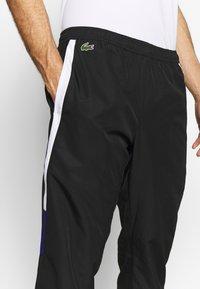 Lacoste Sport - TENNIS PANT - Tracksuit bottoms - black/white/cosmic - 4