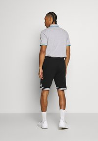 Lacoste Sport - Sports shorts - black/white - 2