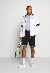 Lacoste Sport - Sports shorts - black/white - 1