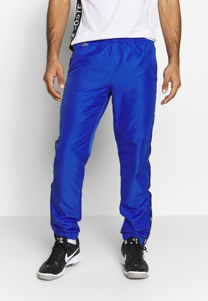 TENNIS PANT TAPERED - Spodnie treningowe - obscurity/black