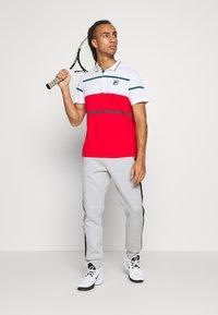 Lacoste Sport - PANT TAPERED - Spodnie treningowe - silver chine/black - 1