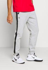 Lacoste Sport - PANT TAPERED - Spodnie treningowe - silver chine/black - 0